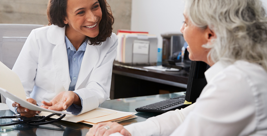 Female patient speaking with her doctor